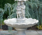 SINGLE TIER LARGE GIRL AND BOY UNDER UMBRELLA FOUNTAIN